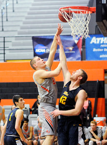 Don Knight | The Herald Bulletin Anderson University's Cole Hartman shoots as he is guarded by Mount St. Joseph's Mitch Moorhead on Saturday.