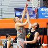Don Knight | The Herald Bulletin<br /> Anderson University's Cole Hartman shoots as he is guarded by Mount St. Joseph's Mitch Moorhead on Saturday.