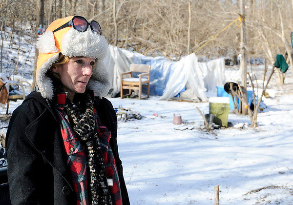 Don Knight   The Herald Bulletin<br /> Skip Ockomon delivered some sandwiches and checked on Penny and others living in a homeless camp in Anderson on Wednesday. Several people had left the camp but a few like Penny chose to stay and said they were staying warm.
