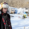 Don Knight | The Herald Bulletin<br /> Skip Ockomon delivered some sandwiches and checked on Penny and others living in a homeless camp in Anderson on Wednesday. Several people had left the camp but a few like Penny chose to stay and said they were staying warm.