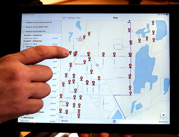 John P. Cleary   The Herald Bulletin    MADISON<br /> Todd Harmeson, of Madison County Emergency Management, shows some of the features of the new app they use when dispatched to a scene.