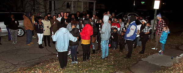 A number of people joined in a candlelight service at Ninth and Chestnut Streets on Friday evening to show their support for the family of slain Tommie Griffin.  (Mark Maynard photo)
