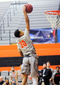 Don Knight | The Herald Bulletin Anderson University's Malik Laffoon dunks on a fast break after stealing the ball from Mount St. Joseph on Saturday.