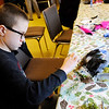 Don Knight | The Herald Bulletin<br /> Graham Greer, 9, puts the finishing touches on his mask during a Nature Mask Workshop at Mounds State Park on Saturday.