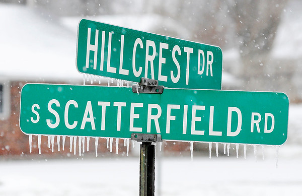 Don Knight | The Herald Bulletin Icicle hand from the street sign at Scatterfield and Hillcrest as freezing rain and sleet changed over to snow Saturday afternoon.