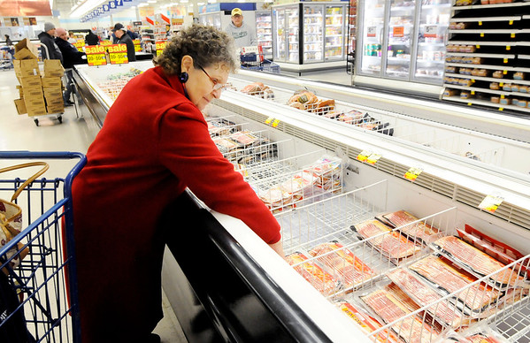 Don Knight | The Herald Bulletin Charlotte Allender picks out a package of bacon while doing her grocery shopping at Meijer on Wednesday. The store was much busier than usual with a pair of winter storms forecast to hit central Indiana Thursday and Saturday.