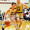 Don Knight | The Herald Bulletin<br /> Alexandria's Cade Vernetti drives as his is guarded by Lapel's Noah Frazier during the Madison County Tournament semifinal at Alexandria on Thursday.