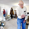 John P. Cleary | The Herald Bulletin<br /> Allen Beaty, foreground right, gives an interior door a fresh coat of paint as Dick Hines, background, does the same as volunteers for Habitat for Humanity<br /> work on rehabbing a house on Morton Street in Anderson this week.