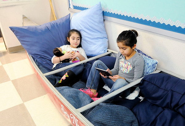 Don Knight   The Herald Bulletin<br /> From left, Guadalupe Lemus and Aaliyah Ogburn sit in a canoe filled with pillows during the opening of the new awards room at Anderson Elementary on Wednesday.