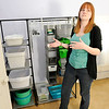 Don Knight | The Herald Bulletin<br /> Organization professional Bethany Clayton keeps a supply of bins on hand she can use when helping a client sort through clutter.