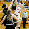 Don Knight | The Herald Bulletin<br /> Alexandria's Jada Stansberry drives to the basket as Madison-Grant's Kayla Comer attempts to block her on Thursday.