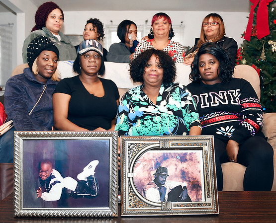 John P. Cleary   The Herald Bulletin<br /> Joyce Griffin, seated third from left, mother of homicide victim Tommie Griffin, is surrounded by daughters, Marjean Neal, left of her, and Cherie Griffin, right, along with extended family members as they mourn the death of Tommie Griffin.