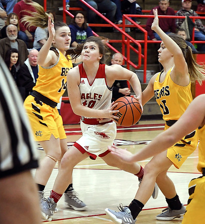 John P. Cleary   The Herald Bulletin<br /> Frankton's Grace Alexander drives the lane between two Monroe Central defenders.