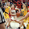 John P. Cleary | The Herald Bulletin<br /> Frankton's Grace Alexander drives the lane between two Monroe Central defenders.