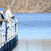 Don Knight | The Herald Bulletin<br /> From left, Robert Smock and Marcus Card fish from the pier at Shadyside Park on Saturday. Temperatures hit the 50s on Saturday but the National Weather Service is forecasting a return to highs in the 30s by midweek.