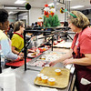 Don Knight | The Herald Bulletin<br /> Toni Johnson puts out fruit cups during lunch at Highland Middle School on Friday.