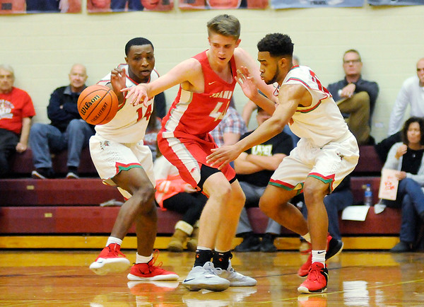 Don Knight   The Herald Bulletin<br /> Anderson's Jesse Sawyer and Brandon Haralson double team Frankton's Rylan Detling during the Madison County Tournament semifinal at Alexandria on Thursday.