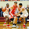 Don Knight | The Herald Bulletin<br /> Anderson's Jesse Sawyer and Brandon Haralson double team Frankton's Rylan Detling during the Madison County Tournament semifinal at Alexandria on Thursday.