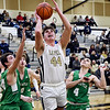 John P. Cleary | The Herald Bulletin<br /> Lapel's Luke Richardson splits the New Castle defense as he goes up for a shot.