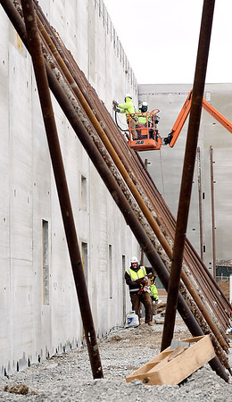 John P. Cleary | The Herald Bulletin<br /> Construction workers work both high and low among the support braces for the concrete walls of the Pendleton Heights High School expansion project Thursday.