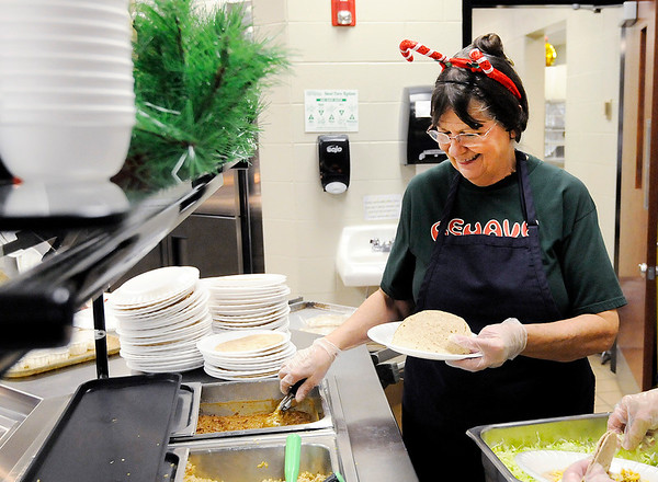 Don Knight   The Herald Bulletin<br /> Karen Johns serves tacos during luch at Highland Middle School on Friday.