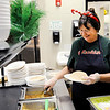 Don Knight | The Herald Bulletin<br /> Karen Johns serves tacos during luch at Highland Middle School on Friday.