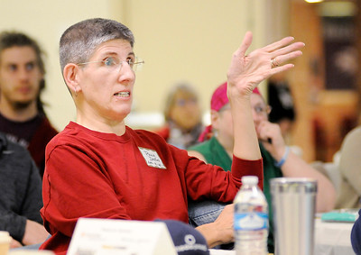 Don Knight | The Herald Bulletin Paula Dalton talks about avoiding food waste by composting produce that is no longer good to eat during a local food summit held by the Madison County Local Food Network at the Anderson Impact Center on Thursday.