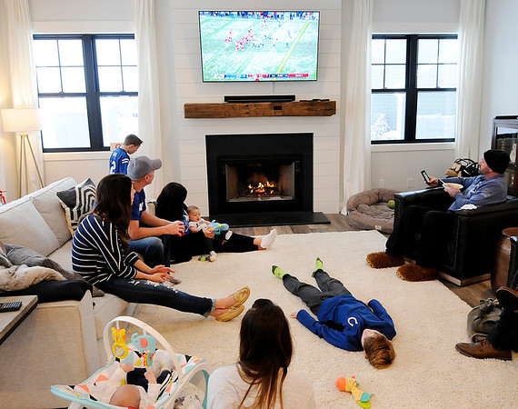 Don Knight   The Herald Bulletin<br /> Hawthorn Hoodrats, headed by Lapel Football Coach Tim Miller, watch the Colts play Kansas City in the Divisional Playoff game on Saturday.