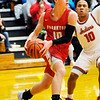 Don Knight | The Herald Bulletin<br /> Frankton's Brayton Cain looks to pass as he is guarded by Anderson's Joseph Jones during the Madison County Tournament semifinal at Alexandria on Thursday.
