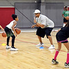 John P. Cleary | The Herald Bulletin<br /> Ben Gibbs gives instructions to a participant during his Winter Skills Camp for youth at the Youth Center field house Wednesday.