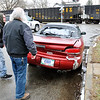 John P. Cleary | The Herald Bulletin<br /> The passenger in this car, left, talks to a area resident after escaping injury as the vehicle was struck by a CSX train Monday afternoon in the 1600 block of Walnut Street. According to police on the scene the car was heading south on Walnut when the brakes failed approaching the crossing, the driver then accelerated to beat the oncoming train but was clipped in the left rear corner and spun around 180 degrees and ended up facing north next to the curb as if it was parked there. The driver also was uninjured in the incident.