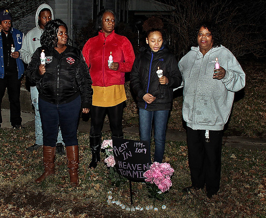 As family members stand with her behind a memorial sign, Joyce Griffin, right, mother of murder victim Tommie Griffin, thanks those gathered at a candlelight rememberance service for their care and support. (Mark Maynard photo)