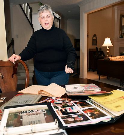 John P. Cleary | The Herald Bulletin<br /> Sonya Eddy retired as director of the Madison County Music Makers after 55 years looks over scrap books from over the years.
