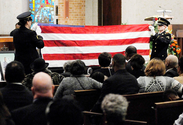 Don Knight | The Herald Bulletin<br /> A honor guard folds the flag that had draped Johnny Wilson's casket at the First United Methodist Church on Saturday. Wilson was an Army veteran.