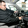 John P. Cleary | The Herald Bulletin<br /> Tom Wood Honda salesman Corey Pritt shows the push button start feature of this Honda with the vehicle fob. The fob has to be within three feet of the car for the starting system to work.