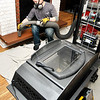 John P. Cleary | The Herald Bulletin<br /> Brian Matheney, of Soot & Cinders Chimney Sweeping, vacuums up after cleaning the chimney as they prepare to install a fireplace insert in this rural Madison County home Monday.