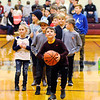 Don Knight | The Herald Bulletin<br /> Kids line up at the free throw line for a chance to win a Pizza Hut Personal Pan Pizza during the Madison County Tournament semifinal at Alexandria on Thursday. Pizza Hut is sponsoring the tournament and you can read about the results in today's Sports section.
