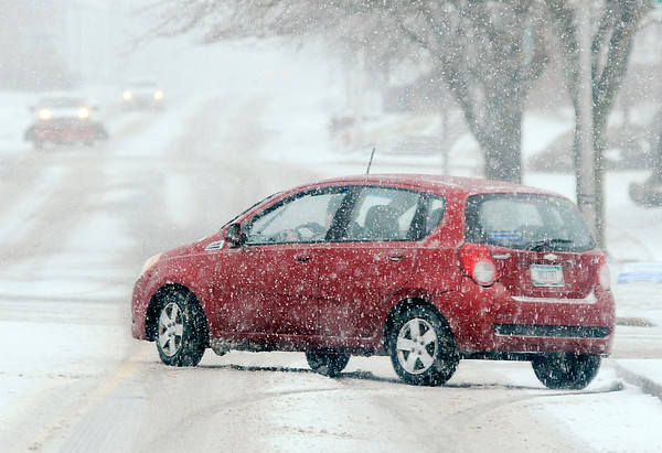 Don Knight | The Herald Bulletin A motorists slides to a stop on 14th Street on Saturday afternoon.