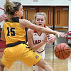 John P. Cleary | The Herald Bulletin<br /> Frankton's Bailey Tucker makes a bounce pass around Monroe Central's Hannah Bolton as she tries to block the pass.