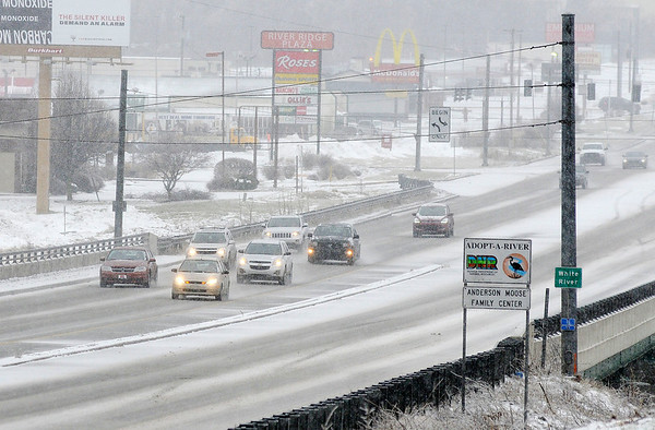 Don Knight | The Herald Bulletin Motorists cross the bridge over the White River on Scatterfield as freezing rain and sleet changed over to snow Saturday afternoon.