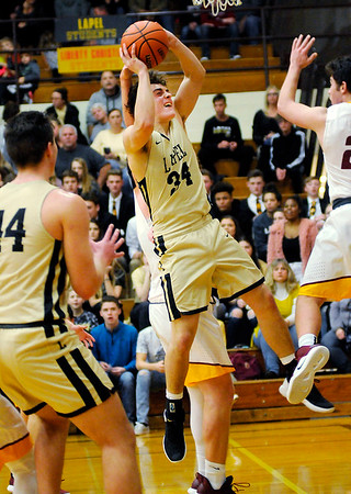 Don Knight   The Herald Bulletin<br /> Lapel's Cole Alexander drives the baseline during the Madison County Tournament semifinal at Alexandria on Thursday.
