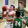 John P. Cleary | The Herald Bulletin<br /> Lapel's Luke Richardson goes up for a shot as New Castle's Brandon Matney tries to block the shot from behind.