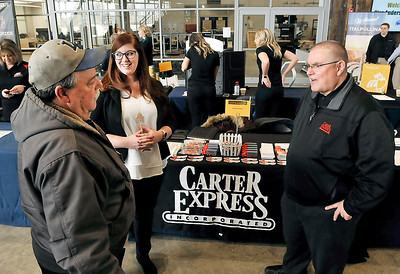 John P. Cleary | The Herald Bulletin Floyd Loveall talks to Jennifer Watts and Jim Fairfield, corporate recruiters for Carter Express, during the Hire Anderson Job Fair Friday at Purdue Polytechnic.