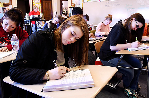 John P. Cleary | The Herald Bulletin<br /> Briyah Badgley, a junior, writes in her journal in Debbie Kinner's Liberty Christian School composition class.
