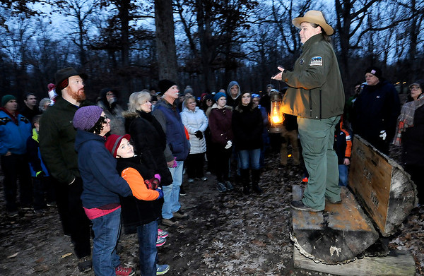 Don Knight   The Herald Bulletin<br /> Naturalist Kelly Morgan talks about the legacy of conservationist John Muir  during a First Day Hike at Mounds State Park on Tuesday.