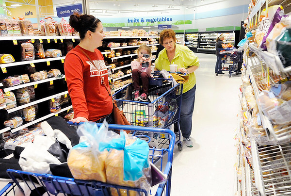 Don Knight | The Herald Bulletin From left, Katie York shops with her daughter Elana, 4, and grandmother Ruth Woodring at Meijer on Wednesday. The weekend forecast is calling for another winter storm but this one will include high winds and drifting snow.