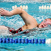 John P. Cleary | The Herald Bulletin<br /> Elwood's Madi Tincher finishes strong as she placed second in the 200 free style against Clinton Central Monday evening.