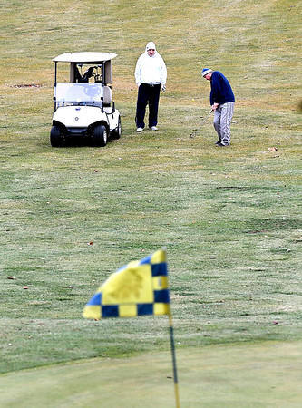 With temperatures in the low 50's these golfers, dressed in their sweatshirts and hats, worked to keep their game sharp as they hit the links at Grandview Golf Course Thursday afternoon.