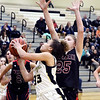 Lapel's Delany Peoples makes a move around Wapahani's Camryn Wise for a shot under the basket.