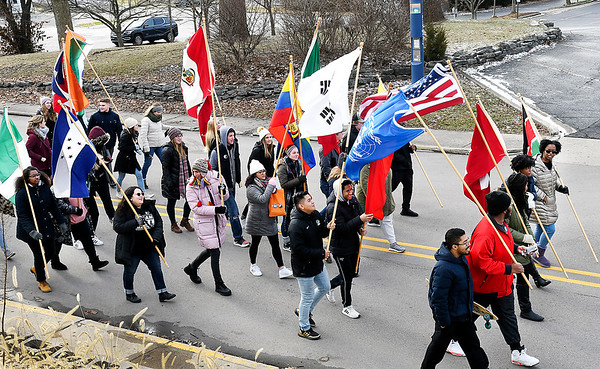 Anderson University students and staff walk along East 8th Street with their international flags as they participate in the Peace and Justice March as part of the university's Martin Luther King Jr. Celebration Monday. From the city-wide celebration uptown at the Paramount the group marched back to AU's campus where they held forums and service projects.